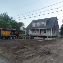 An old house lifted for a new foundation - Payne Construction Services