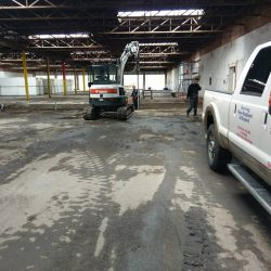 Team of contractors and their trucks working on a commercial project - Payne Construction Services