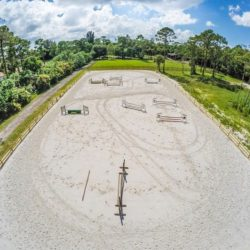 An aerial view of our arena used for riding lessons - Pink Flamingo Stables