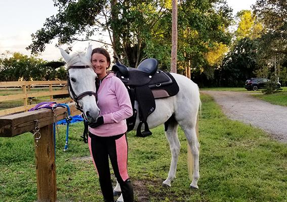rider hugging horse