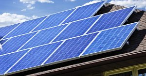 Large blue solar panels cover roof on house
