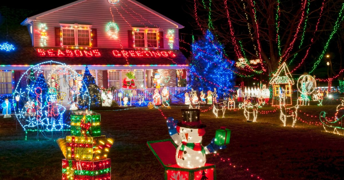 House with Christmas decorations and lights throughout yard
