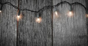 Wooden fence with lights strung across it