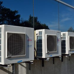 Four AC units on top of building