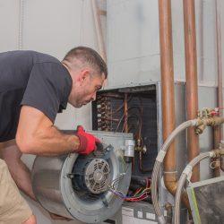 HVAC technician replacing motor