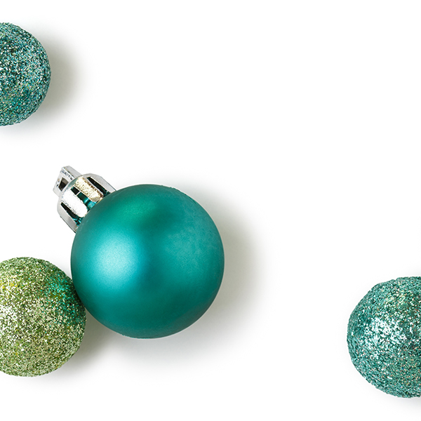 Image of Christmas ornaments in blue and green colors on a white background