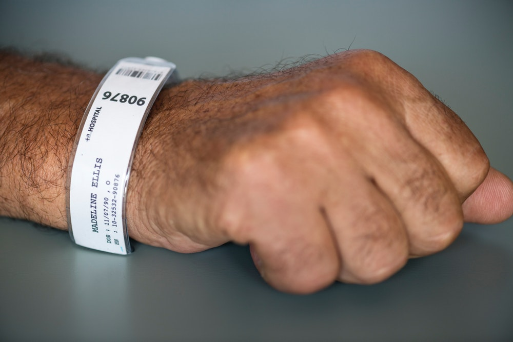 Person With Hospital Tag Labeled