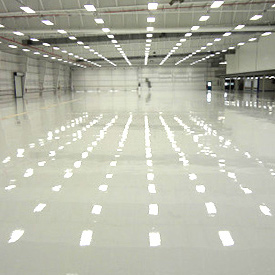 Empty warehouse with glossy epoxy floors