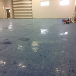 Empty building with supplies for epoxy flooring installation