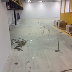 Empty industrial warehouse preparing for epoxy floor installation