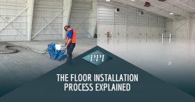 Worker with orange vest installing new concrete floor