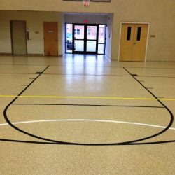 Gym epoxy flooring with basketball hoop