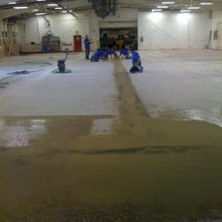 Empty warehouse being prepared for epoxy floor coating