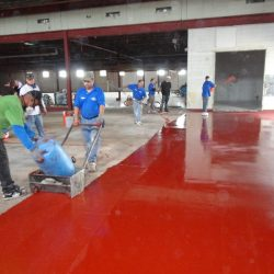 Red urethane concrete flooring installed by professionals