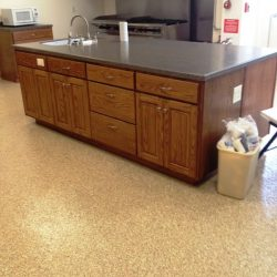 Epoxy floors in restaurant kitchen with granite counters