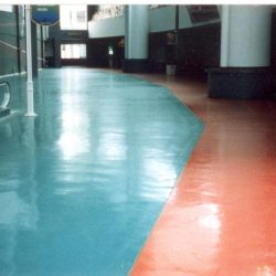 Red and blue epoxy urethane flooring in stadium