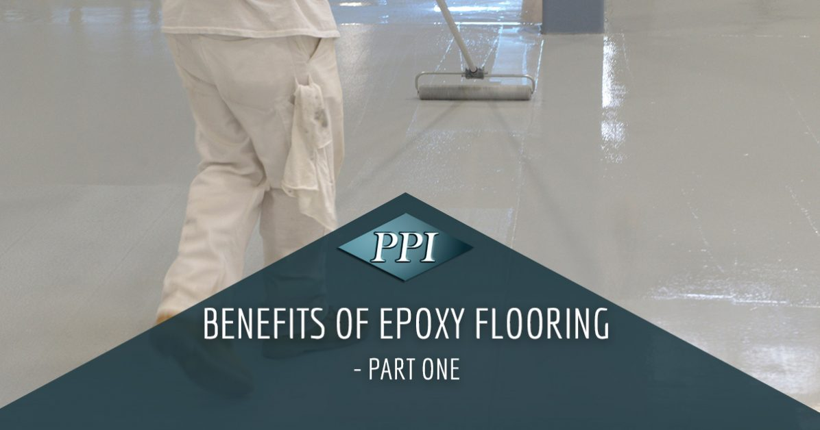 New epoxy flooring being installed by professional in white clothes