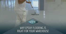 Worker in white clothes finishing an epoxy floor
