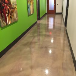 Brown epoxy floors in business hallway