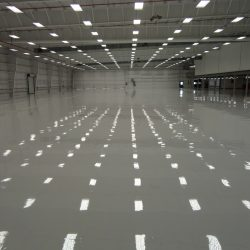 Lights reflecting off of epoxy floor in warehouse