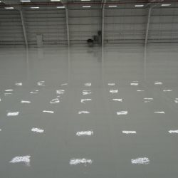 Finished epoxy floors in empty warehouse