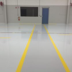 Commercial building with yellow epoxy pathway and blue door