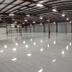 White epoxy floors in warehouse with red poles