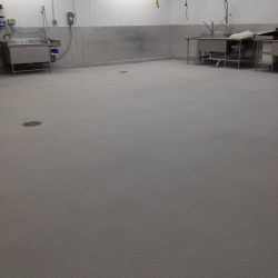 Epoxy floors in empty building with dishwashing equipment