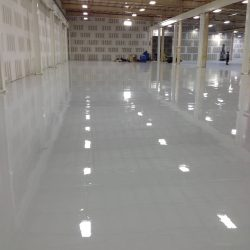 Freshly installed white epoxy floors in empty building