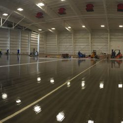 Glossy epoxy floors in airplane hangar