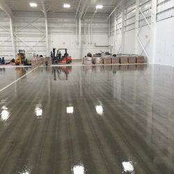bags of concrete in warehouse with reflective floors