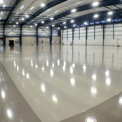 Empty building with white concrete floors