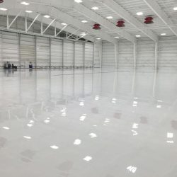 White airplane hangar with red vents and epoxy flooring