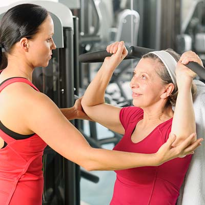 1-bigstock-Personal-trainer-assist-senior-30572534
