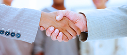An image of two people shaking hands.
