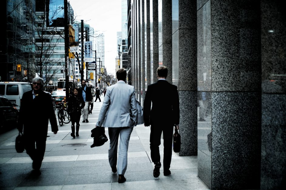 An image of two business men walking down the street.