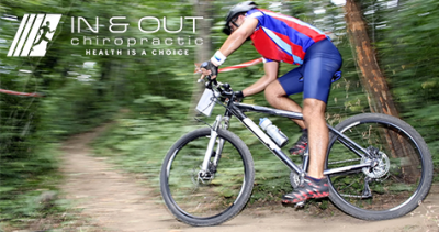 A man speeds around the curve on a dirt path on a mountain bike.