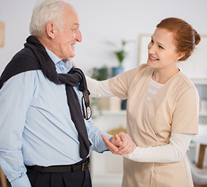 Caregiver Talking With Senior Man