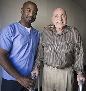 Caregiver Posing With Senior Man