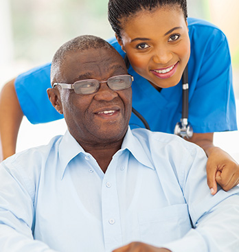 Caregiver and Senior Smiling