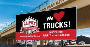 """Ralph's Transmission billboard """"We Love Trucks."""""""