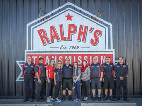 The Ralph's Transmission posing in front of side of the shop.