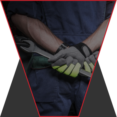An image of a mechanic with their arms crossed neatly behind their back.