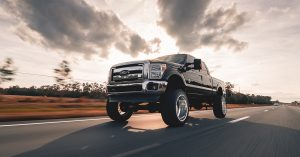 An image of a raised black, Ford truck.