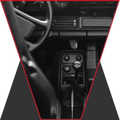The image of a steering wheel and front console with the transmission stick.