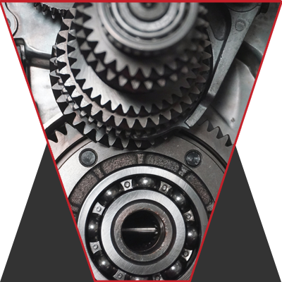 A section of gears in black and white stacked up.