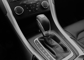 The image of an automatic shifter in a car.