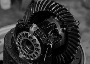 A black and white photo of vehicle components.