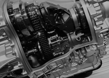 A black and white photo of a sleek transmission.
