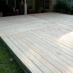 A wood deck built off of a back patio - Ready Decks